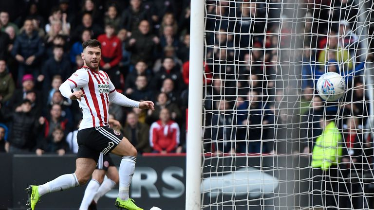 Scott Hogan scored the first goal in Sheffield United's 2-0 win over Ipswich - a result that effectively sealed their return to the Premier League