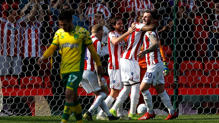 Stoke City's Tom Edwards (right) celebrates scoring his side's second goal against Norwich