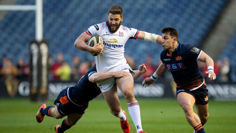 Stuart McCloskey of Ulster is tackled by Mark Bennett and Damien Hoyland (right) of Edinburgh