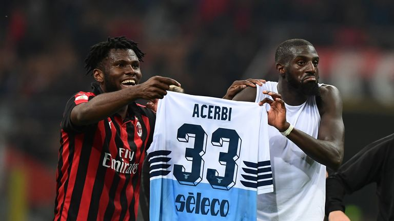Kessie (left) and Bakayoko hold up Francesco Acerbi's shirt following their 1-0 Serie A win over Lazio