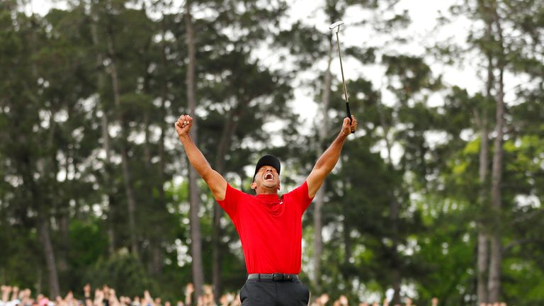 Tiger Woods celebrates after sinking his putt to win the Masters