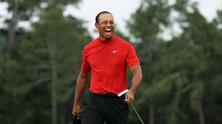 Tiger Woods celebrates after sinking his putt on the 18th green to win The Masters 2019