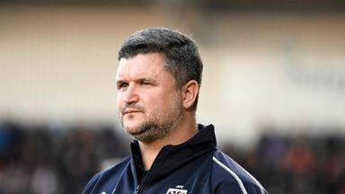 First-team coach Simon Bassey has departed AFC Wimbledon