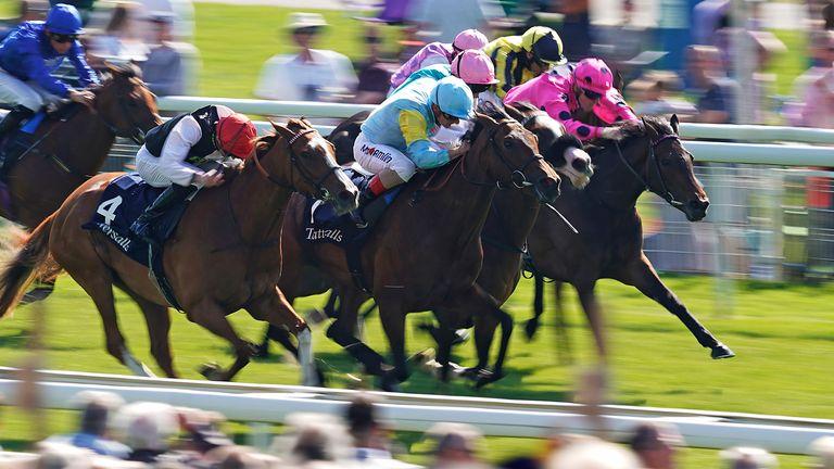 Andrea Atzeni riding Nausha (light blue) win the Tattersalls Musidora Stakes at York