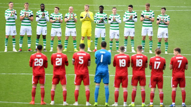 Aberdeen and Celtic players observe a minute's applause for Celtic's legendary European Cup winning captain Billy McNeill, who passed away last week. McNeill also managed Aberdeen for a season.
