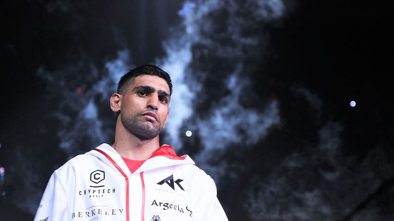 Amir Khan will return to the ring in July