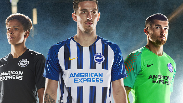 Lewis Dunk models the new Brighton home shirt while the away strip is all back