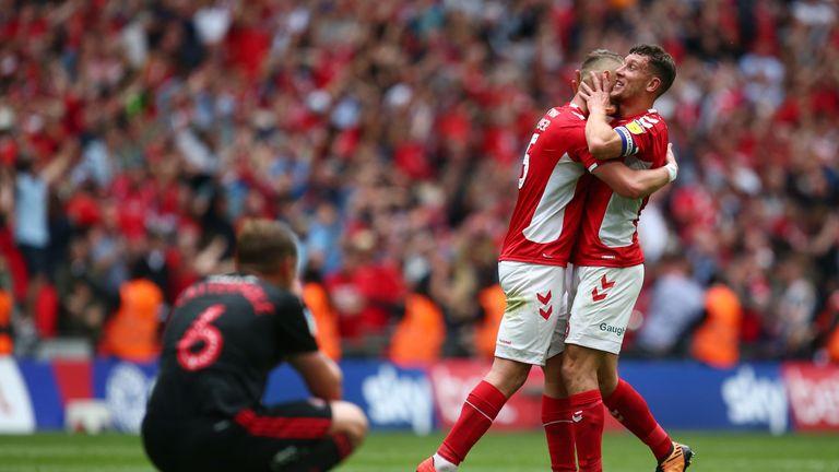 Charlton celebrate as Lee Cattermole looks dejected