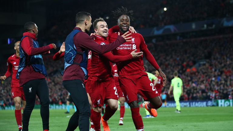 Divock Origi scored twice to help Liverpool progress 4-3 on aggregate