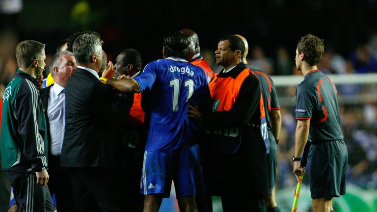 Stewards intervene as Drogba looked to confront Ovrebo over his performance