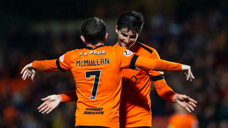 Paul McMullan (C) celebrates win with teammate Ian Harkes.
