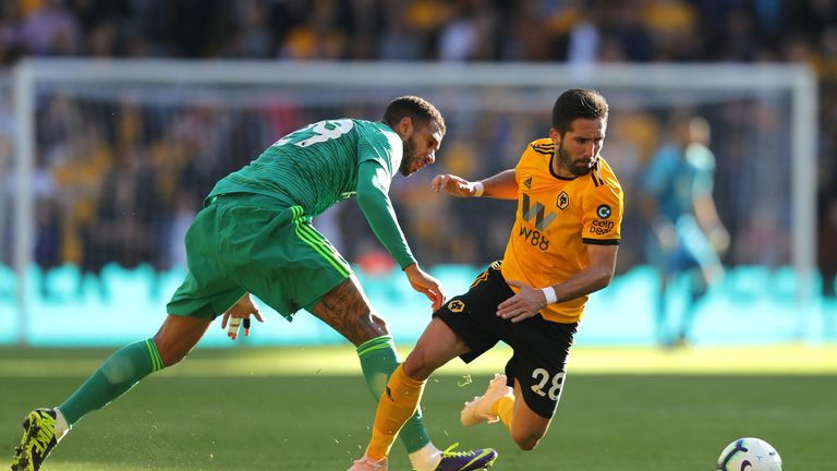 Watford's Etienne Capoue and Wolves' Joao Moutinho in action