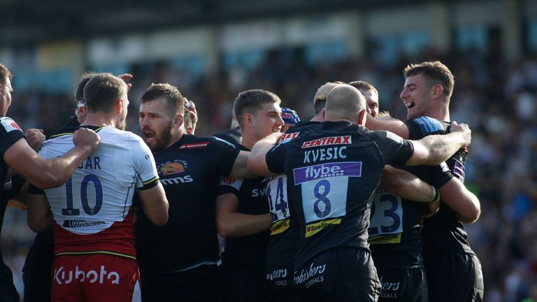 Exeter Chiefs players celebrate their semi-final win