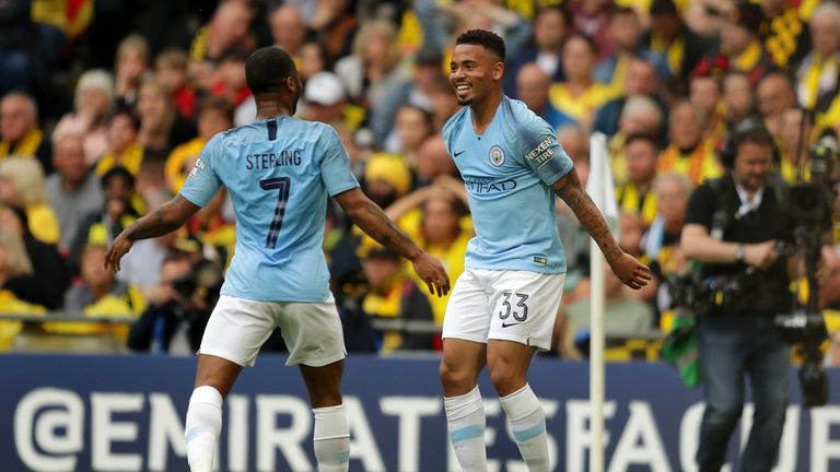 Gabriel Jesus and Raheem Sterling celebrate Manchester City's second against Watford