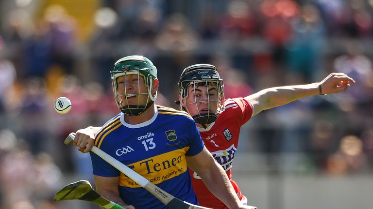John O'Dwyer of Tipperary in action against Cork's Darragh Fitzgibbon during the Munster GAA Hurling Senior Championship Round 1 match