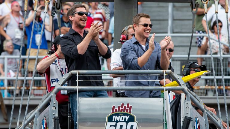 Actors Christian Bale and Matt Damon waved the green flag for the famous race