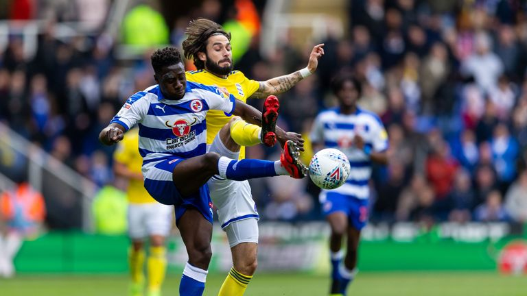 Birmingham City's Jota and Reading's Andy Yiadom in action at the Madejski Stadium