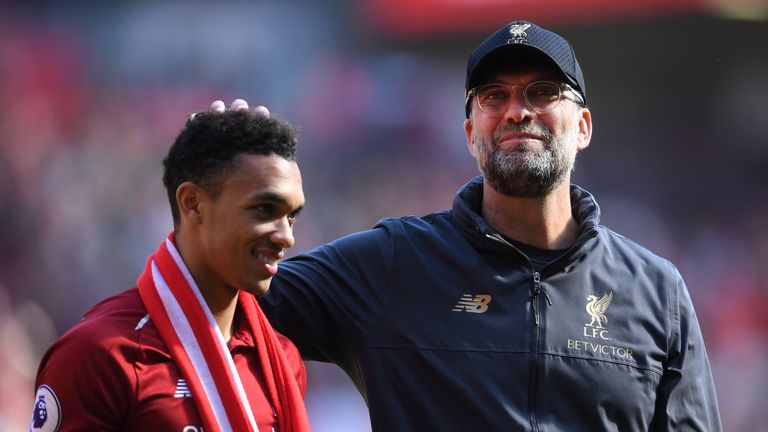 Jurgen Klopp embraces Trent Alexander-Arnold at the final whistle