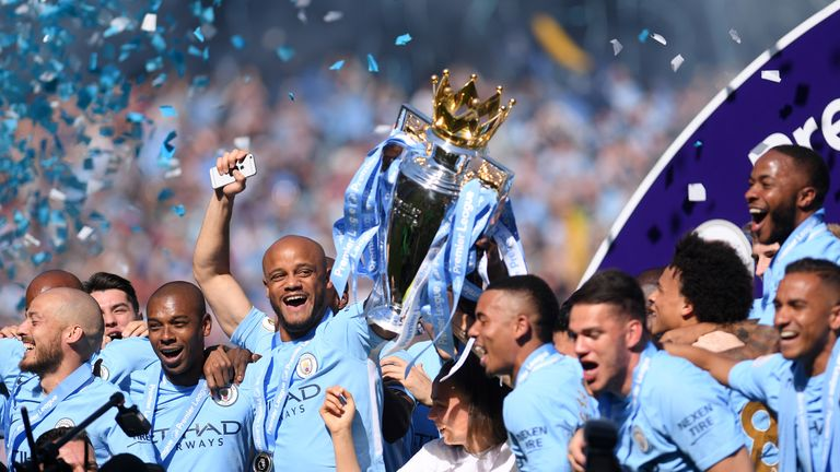 Kompany lifts the Premier League title for the fourth time during his City career