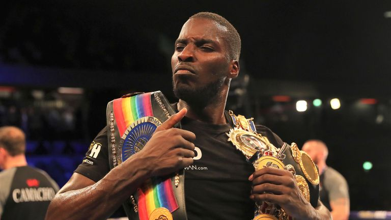 Lawrence Okolie celebrates with British and Commonwealth titles