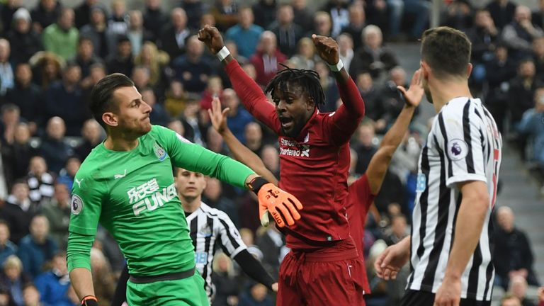 Origi watches his glancing header end up in the Newcastle net at St James' Park