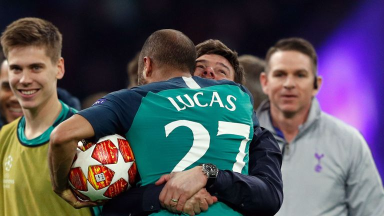 Lucas Moura is embraced by Mauricio Pochettino  after Tottenham beat Ajax to make the Champions League final
