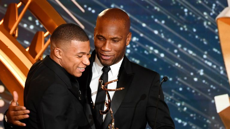 Mbappe was presented with Ligue 1's Player of the Year award by Didier Drogba