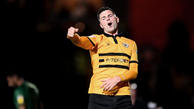 Padraig Amond celebrates scoring the equaliser for Newport