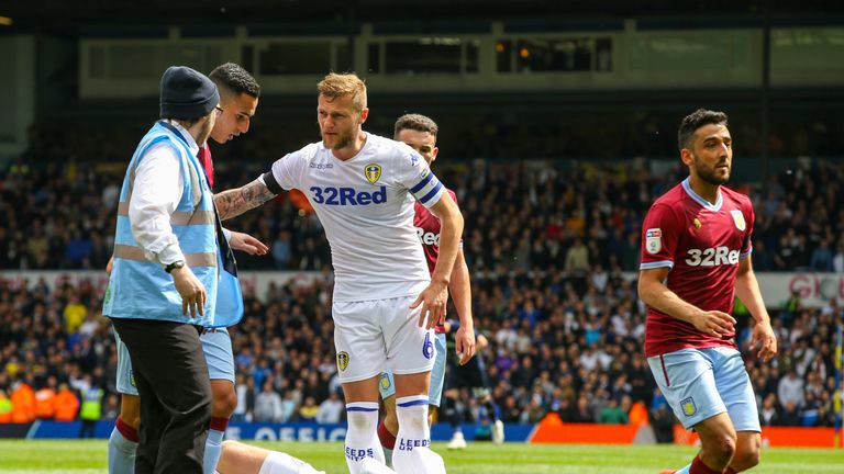 Patrick Bamford clutches his face following an altercation with Anwar El Ghazi