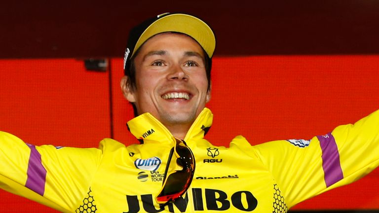 Primoz Roglic celebrates on the podium after winning stage one of the Giro d'Italia