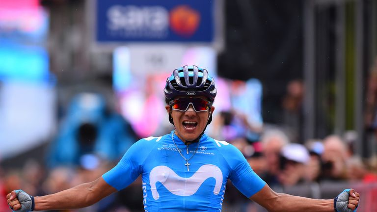 Carapaz celebrates his victory as he crosses the finish line to win stage 14