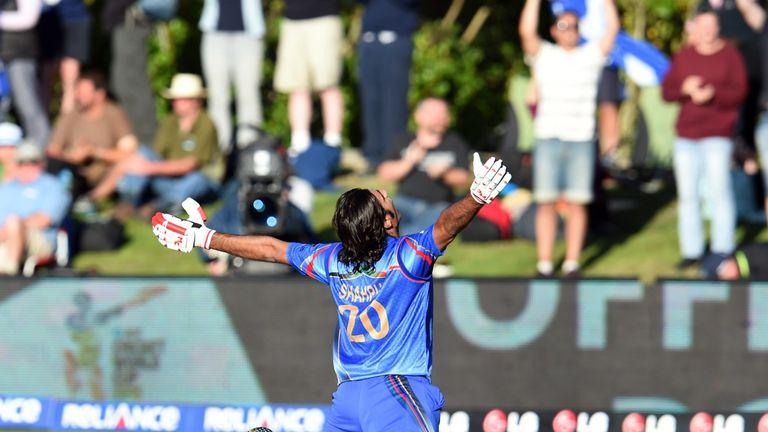 Afghanistan batsman Shapoor Zadran celebrates after hitting the winning runs to defeat Scotland