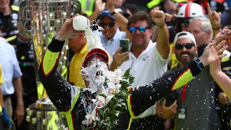 Pagenaud pours milk over himself after winning an epic race