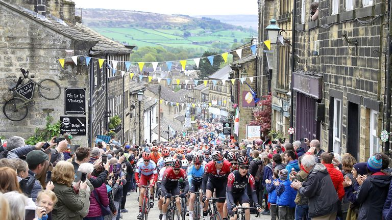 Team Ineos lead the peloton, including leader Lawless, as they climb a hill in Haworth