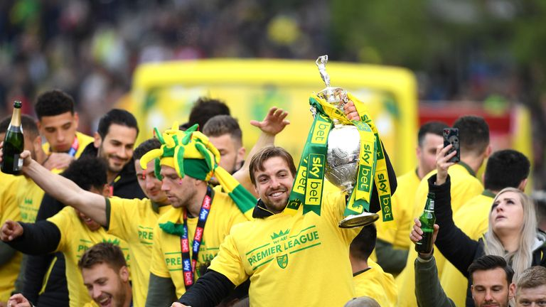 Norwich goalkeeper Tim Krul holds the Sky Bet Championship trophy during the parade