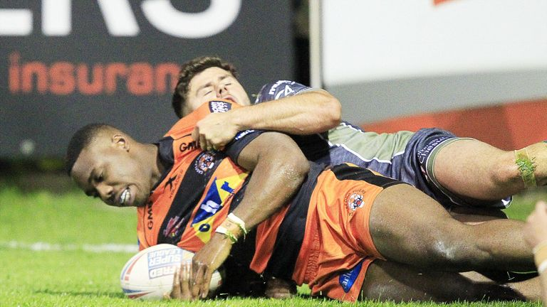 Tuoyo Egodo scores a try as he is tackled by Warrington's Jack Johnson