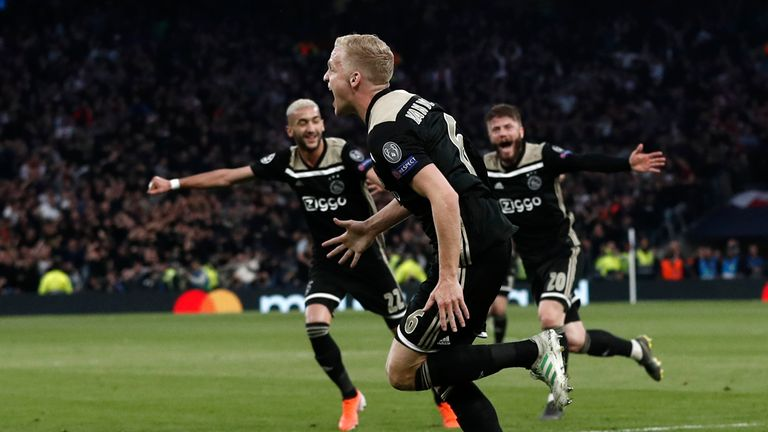 Donny van de Beek wheels away in celebration after his goal