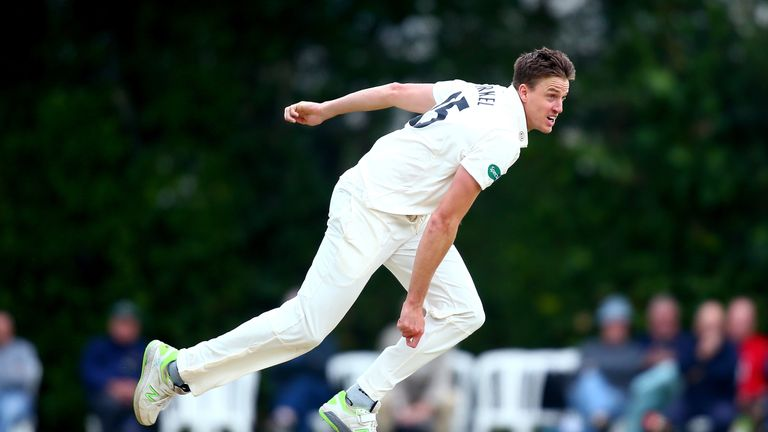 Morne Morkel's three wickets helped Surrey restrict Warwickshire's first innings to 36