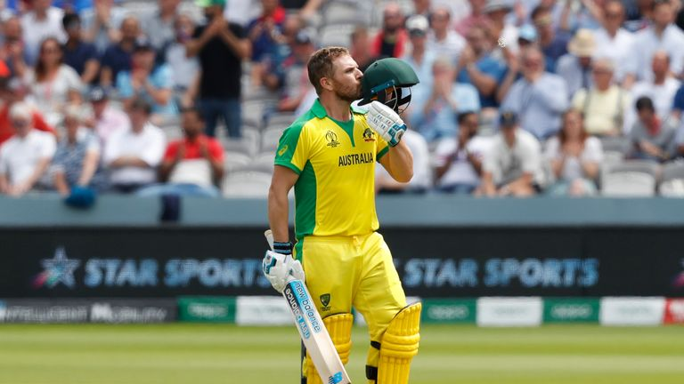Aaron Finch celebrates his second century of the World Cup - only team-mate David Warner has scored more runs than him in the tournament