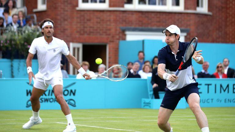 Murray in action with Feliciano Lopez at Queen's Club on Thursday