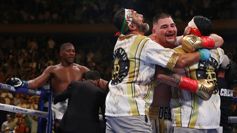 Ruiz Jr and trainer Robles celebrate their stunning shock against AJ