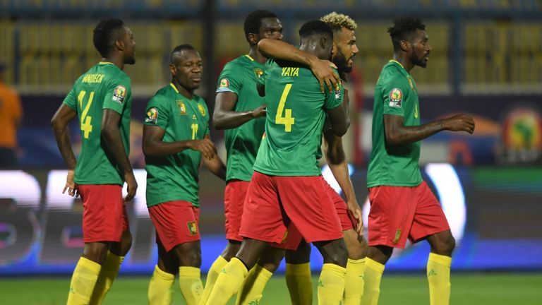 Cameroon's players celebrate their opening goal against Guinea-Bissau