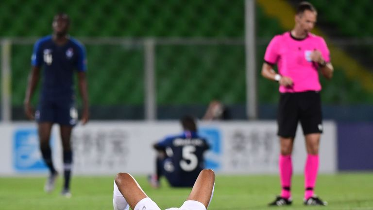 Jake Clarke-Salter lays dejected after England's late defeat to France