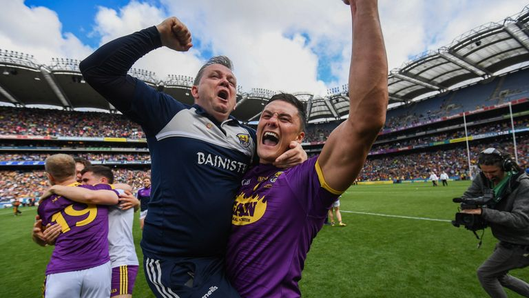 Fitzgerald celebrates with Lee Chin at full-time