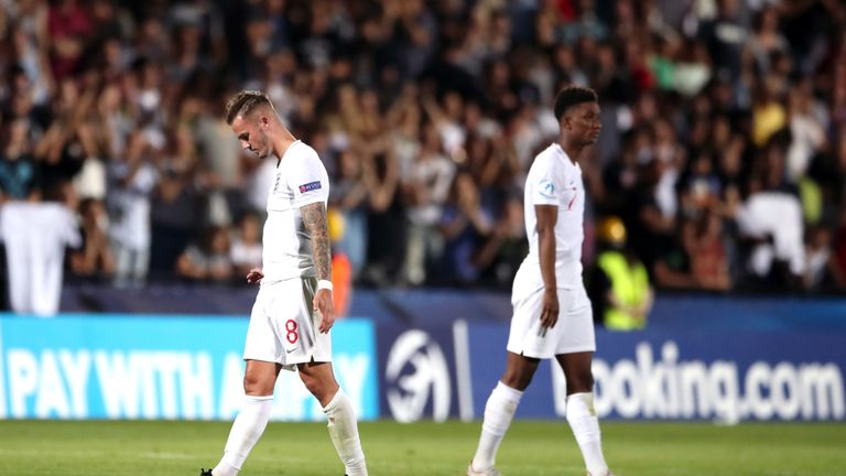 Demarai Gray leaves the field dejected after England's late defeat
