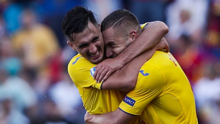 George Puscas (right) scored twice for Romania in the first half