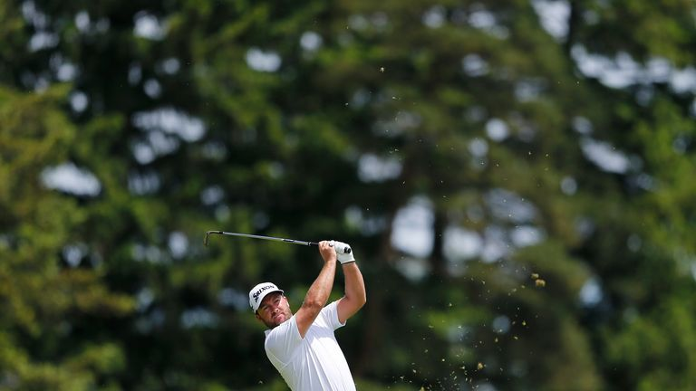 McDowell holed from 30 feet at the last to ensure a berth at his home course of Royal Portrush