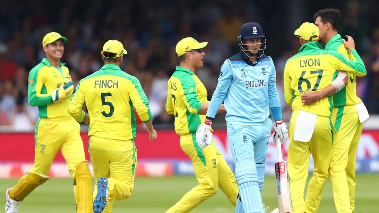 England's Joe Root falls lbw to Australia's Mitchell Starc during the World Cup group stage match