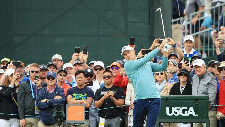 Spieth drove in the water at the eighth and then flew the green with his third