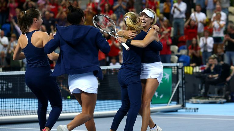 Katie Swan embraces Fed Cup team-mate Katie Boulter as Team GB earn promotion